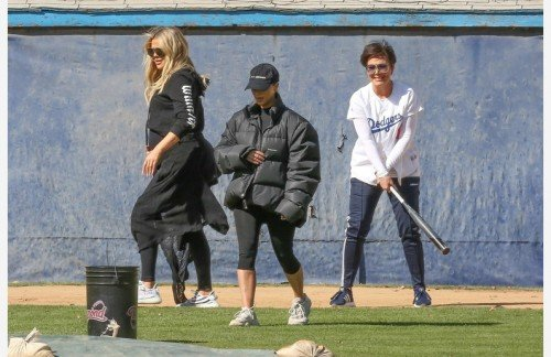 Calabasas, CA  - *EXCLUSIVE*  - Reality stars Kim, Kourtney and Khloe Kardashian get together to have a fun game of softball while filming 'Keeping Up With The Kardashians' with their mother Kris Jenner in Calabasas.  Each of them took turns at the plate while one of them soft pitched softballs for batting practice.  At one point Kim pitched to Kris and nearly took her head off forcing Kris to duck and try to get out of the way, falling down on the ground.  The close call was a little too close for comfort and was obviously not intentional which all the girls had a big laugh after helping Kris get up. Shot on 02/13/18 Pictured: Kim Kardashian, Kourtney Kardashian, Kris Jenner BACKGRID USA 14 FEBRUARY 2018  BYLINE MUST READ: BAHE / BACKGRID USA: +1 310 798 9111 / usasales@backgrid.com UK: +44 208 344 2007 / uksales@backgrid.com *UK Clients - Pictures Containing Children Please Pixelate Face Prior To Publication*