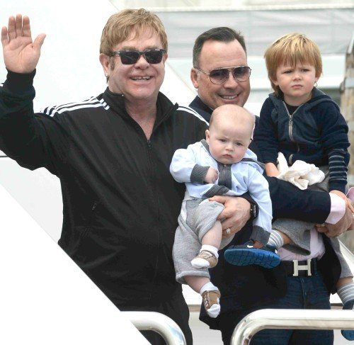 Piano man Elton John and David Furnish arrive in Venice **USA ONLY**