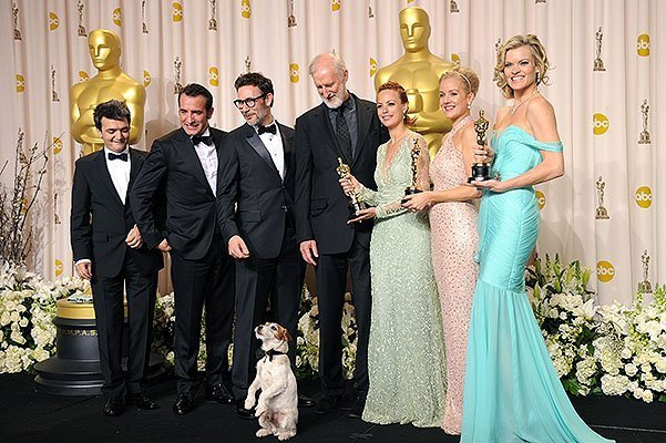 HOLLYWOOD, CA - FEBRUARY 26:  (L-R)  Producer Thomas Langmann, actor Jean Dujardin, director Michel Hazanavicius, actors James Cromwell, Berenice Bejo, Uggie the dog, Penelope Ann Miller, and Missi Pyle  pose in the press room after winning the Best Picture Award at the 84th Annual Academy Awards held at the Hollywood & Highland Center on February 26, 2012 in Hollywood, California.  (Photo by Jason Merritt/Getty Images)