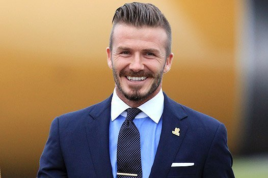 HELSTON, ENGLAND - MAY 18:  David Beckham holds the Olympic Flame as it arrives at RNAS Culdrose near Helston on May 18, 2012 in Cornwall, England. The Olympic Flame arrived in the UK after it was handed over at a ceremony yesterday in Athens. A British delegation including David Beckham, flew back with the flame from Greece where they attended a ceremony welcoming the flame, before it is taken on a 70-day relay involving 8,000 torchbearers covering 8,000 miles.  (Photo by Matt Cardy/Getty Images)