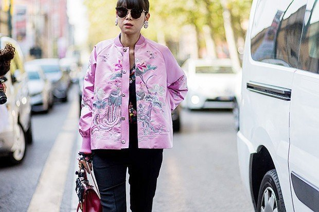MILAN, ITALY - SEPTEMBER 25: Leaf Greener wearing a pink bomber jacket outside Marni during Milan Fashion Week Spring/Summer 2017 on September 25, 2016 in Milan, Italy. (Photo by Christian Vierig/Getty Images)
