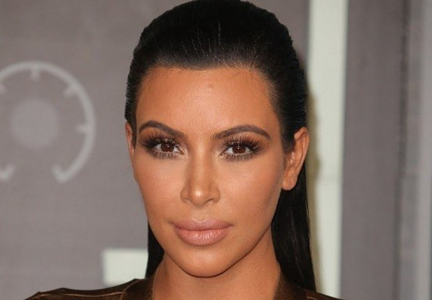 kim-kardashian-drops-lawsuit-after-tabloid-apologizes-for-fake-robbery-claims