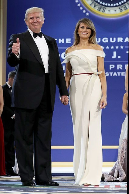 WASHINGTON, DC - JANUARY 20:  U.S. President Donald Trump (L) and first lady Melania Trump thank guests during the inaugural Armed Forces Ball at the National Building Museum January 20, 2017 in Washington, DC. The ball is part of the celebrations following Trump's inauguration.  (Photo by Chip Somodevilla/Getty Images)