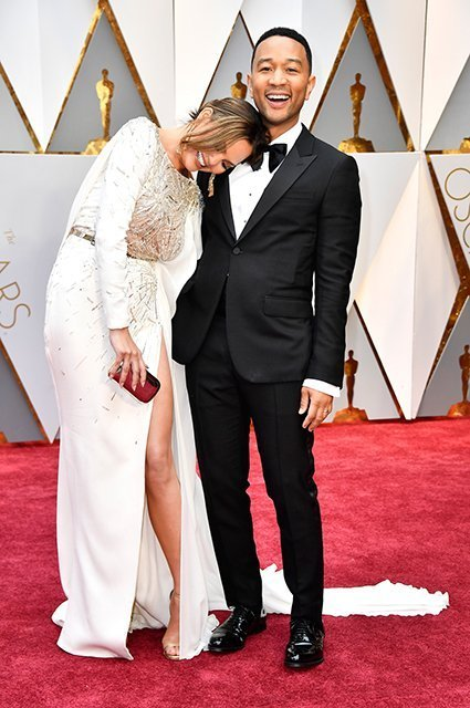 HOLLYWOOD, CA - FEBRUARY 26:  Model Chrissy Teigen (L) and musician John Legend attend the 89th Annual Academy Awards at Hollywood & Highland Center on February 26, 2017 in Hollywood, California.  (Photo by Frazer Harrison/Getty Images)
