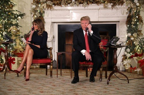 The President And First Lady Assist NORAD With Santa Tracker Phone Calls