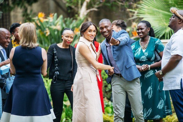 Meghan, Duchess of Sussex(C) arrives at the British High Commissioner residency in Johannesburg where she will meet with Graca Machel, widow of former South African president Nelson Mandela, in Johannesburg, on October 2, 2019. - Prince Harry recalled the hounding of his late mother Diana to denounce media treatment of his wife Meghan Markle, as the couple launched legal action against a British tabloid for invasion of privacy. (Photo by Michele Spatari / AFP) (Photo by MICHELE SPATARI/AFP via Getty Images)