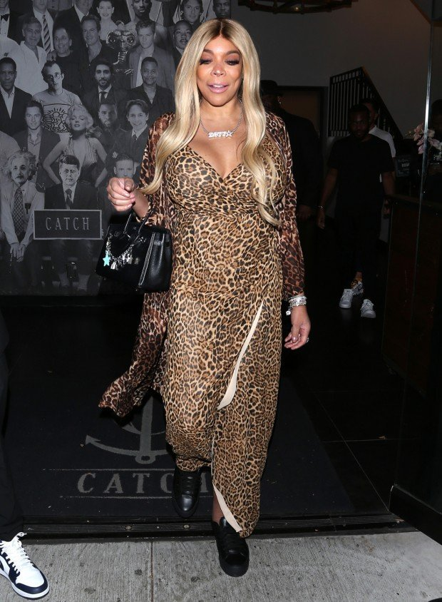Wendy Williams wears a full-length Leopard Print dress as she left dinner at 'Catch' Restaurant in West Hollywood, CA